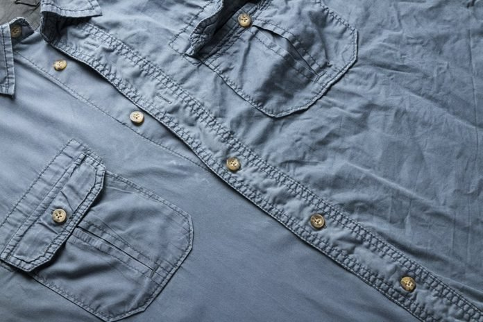 ironed and none ironed men's shirt as full frame concept background
