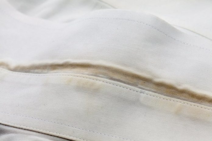 stain of the dirty white shirt