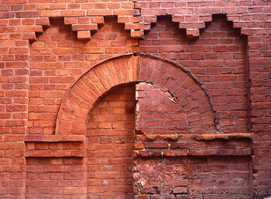 brick wall, with clean and dirty bricks