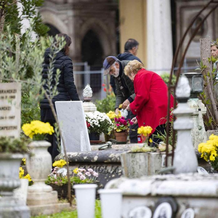 People visit the Monumental Verano Cemetery to honor their loved ones during All Saints' Day, in Rome, Italy