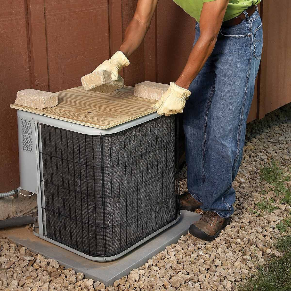 winterize ac unit with plywood protector