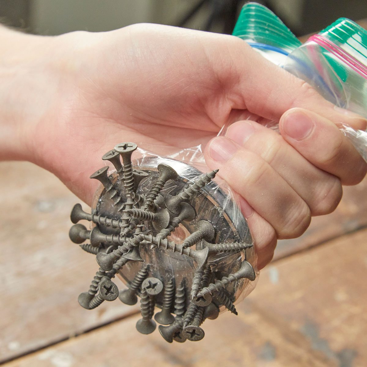 HH pick up a spill of screws with magnet or plastic bag