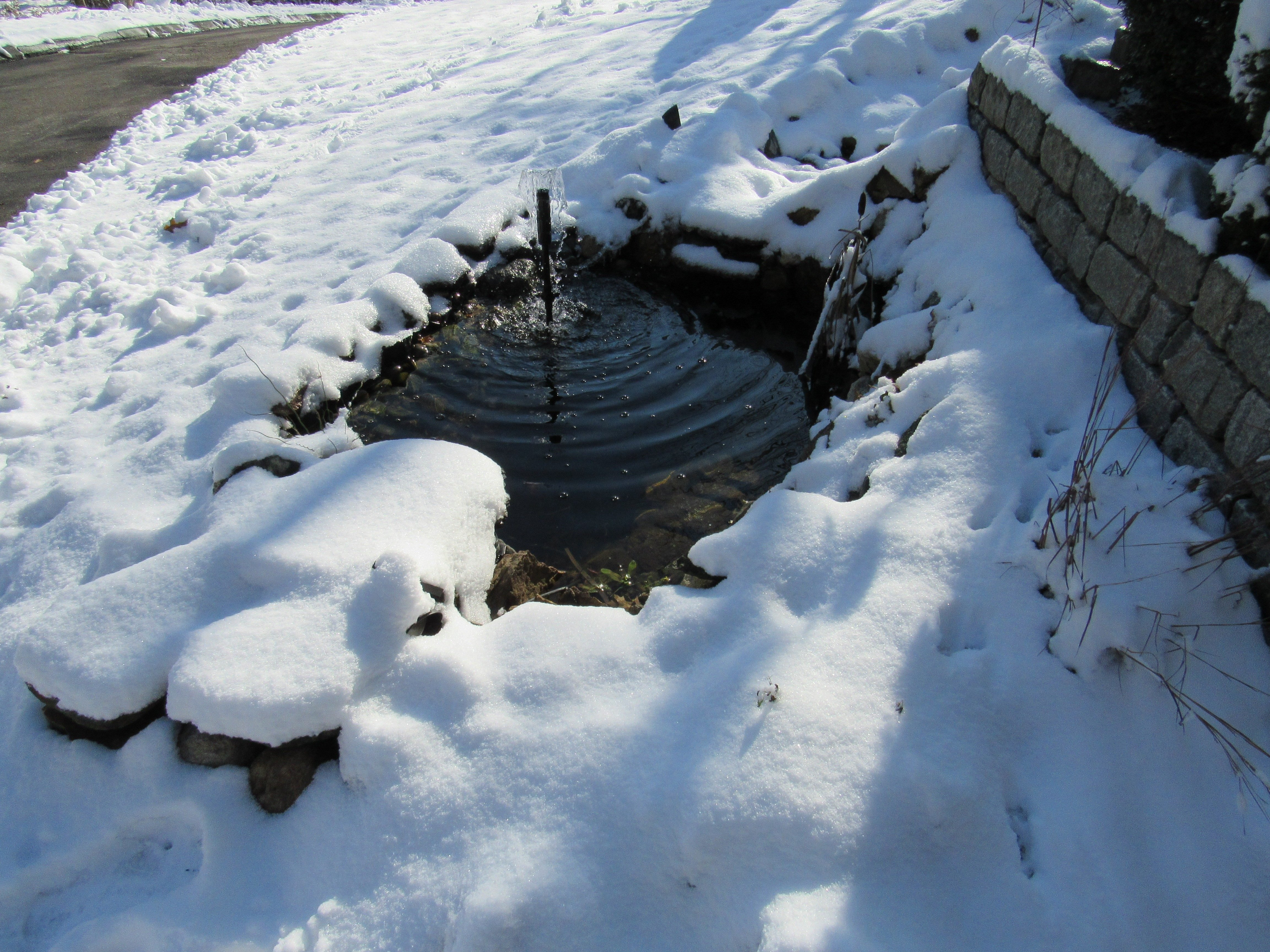 Man made pond after snowfall