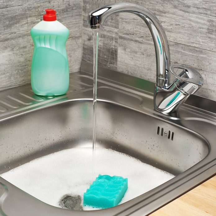 Close up of kitchen sink full of foam with running tap water, green cleaning sponge and bottle of liquid detergent; Shutterstock ID 640551559; Job (TFH, TOH, RD, BNB, CWM, CM): TOH