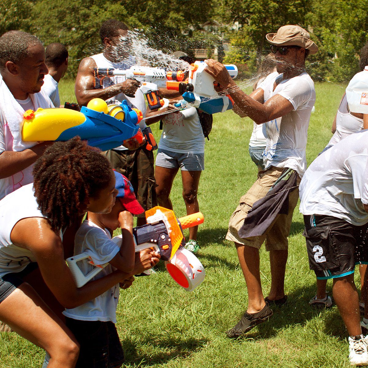 Unidentified people take part in a water gun battle called the Fight4Atlanta, a squirt gun fight between dozens of locals at Freedom Park on July 28, 2012 in Atlanta.