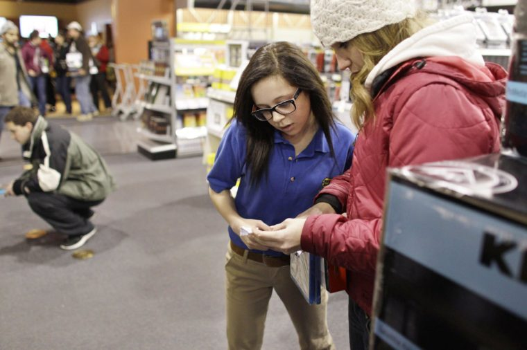 Best Buy electronics store employee Maddy Cooke, a criminology major in college, helps a customer looking to purchase an item, during a Black Friday sale that started at midnight, in Broomfield, Colo., early . Black Friday, the day when retailers traditionally turn a profit for the year, got a jump start this year as many stores opened just as families were finishing up Thanksgiving dinner