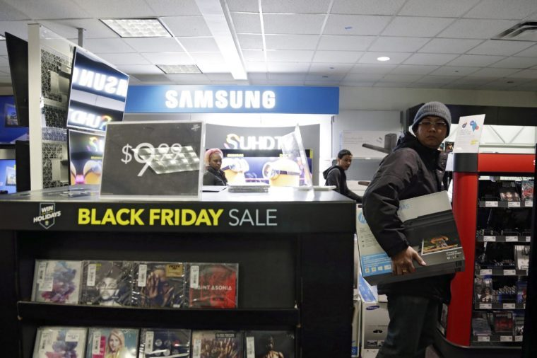People Shop For Black Friday Bargains at the Best Buy in Midtown Manhattan in New York New York Usa 27 November 2015 Black Friday is the Day Following Thanksgiving and the Traditional Beginning of the Christmas Shopping Season in Recent Years Retailers Have Been Opening on Thanksgiving United States New York