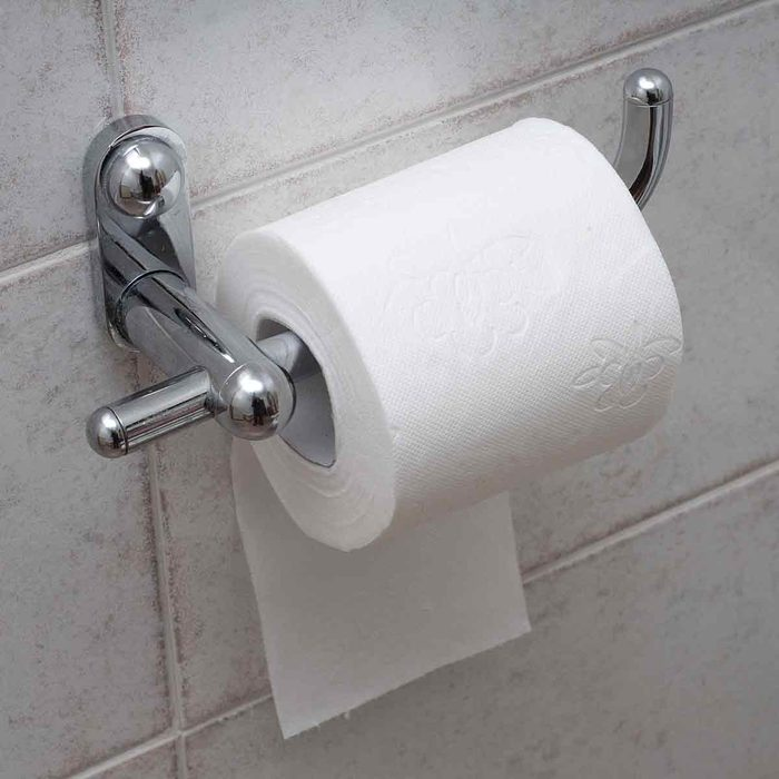 Roll-of-toilet-paper-on-a-toilet-paper-holder