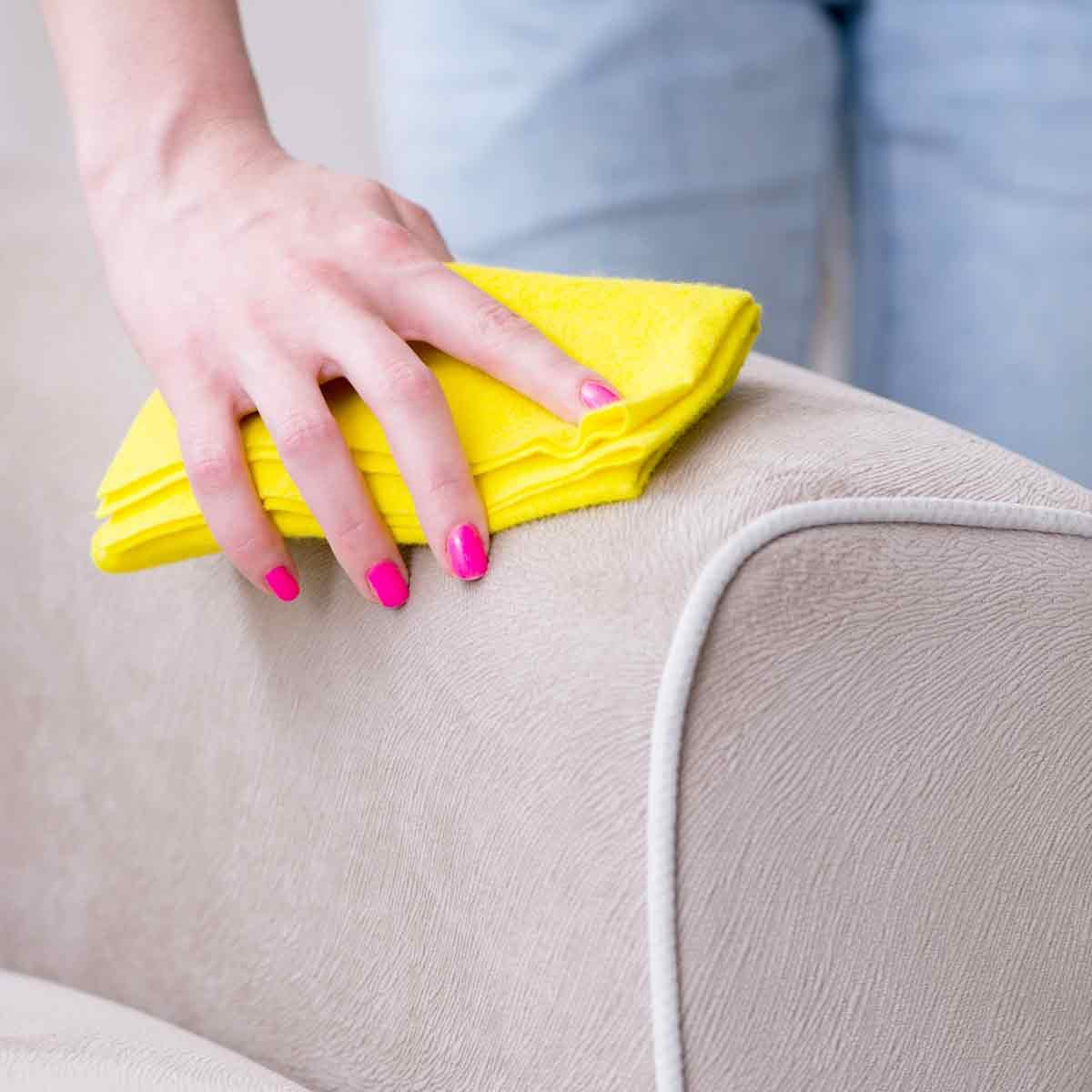 Woman-cleaning-a-couch