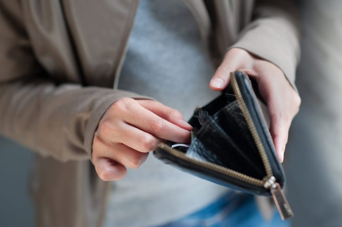 Little girl with wallet and her fingers