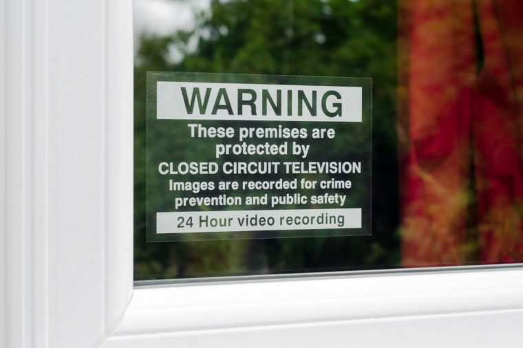 Warning these premises are protected by CCTV sign on the window of a protected property.