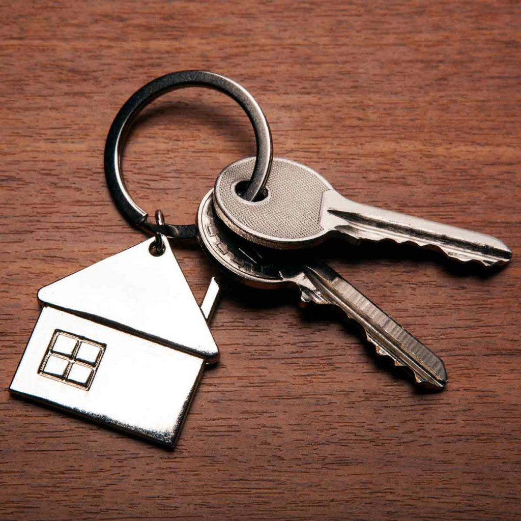 keys-from-the-apartment-with-a-keychain-in-the-form-of-a-house-close-up