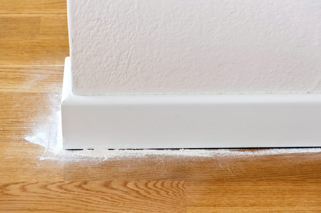 Insect powder between parquet and wooden baseboards