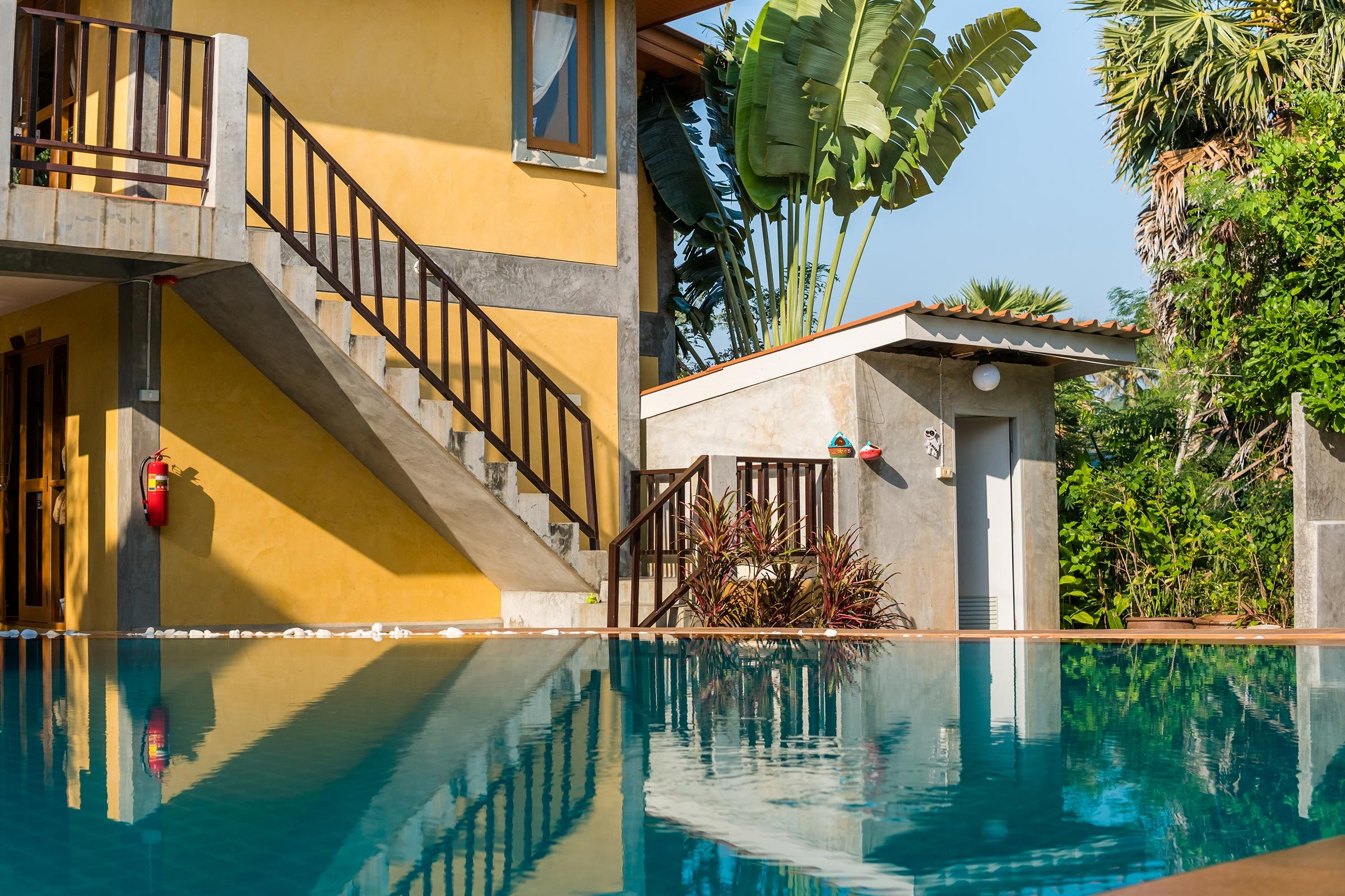 Outdoor inground residential swimming pool in backyard