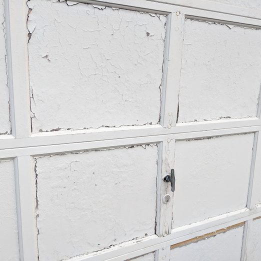 White Garage Door Panels with Old, Flaking Paint; Garage Doors that Need to Be Replaced