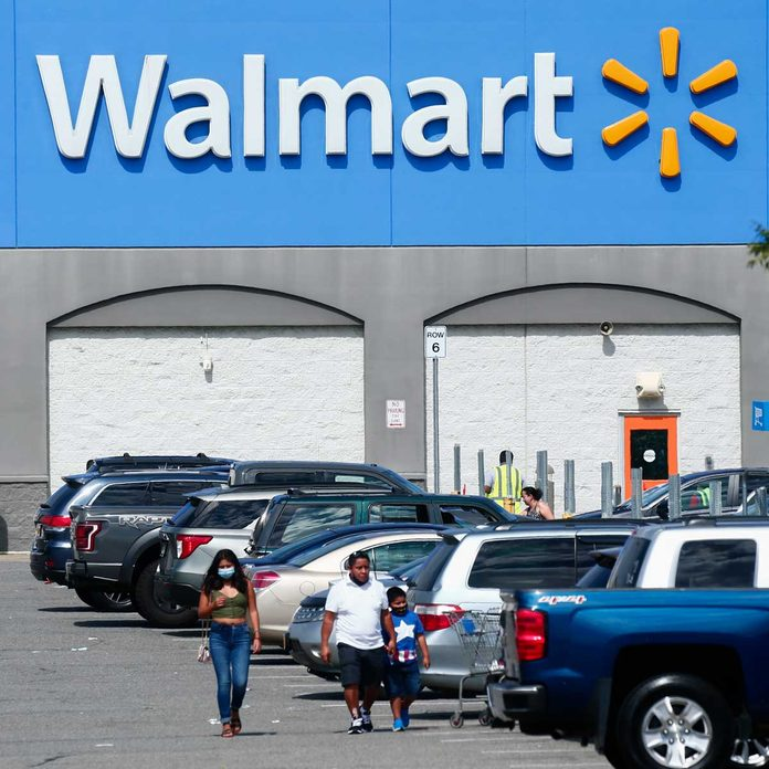 People walking in a Walmart parking lot