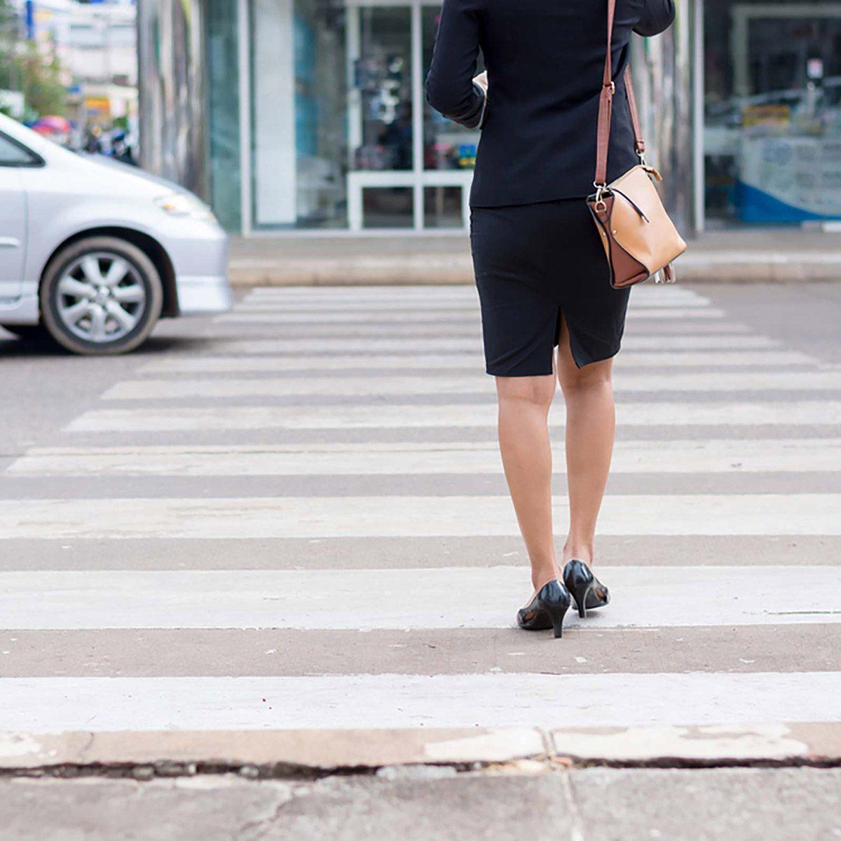 street walking across the street crosswalk