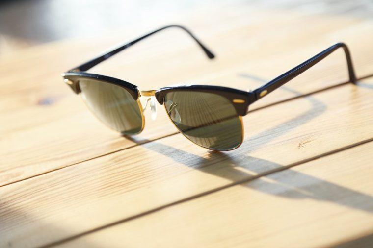 Fashion sunglasses on a wood table