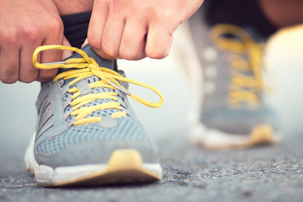 Runner tying shoelaces on sneakers