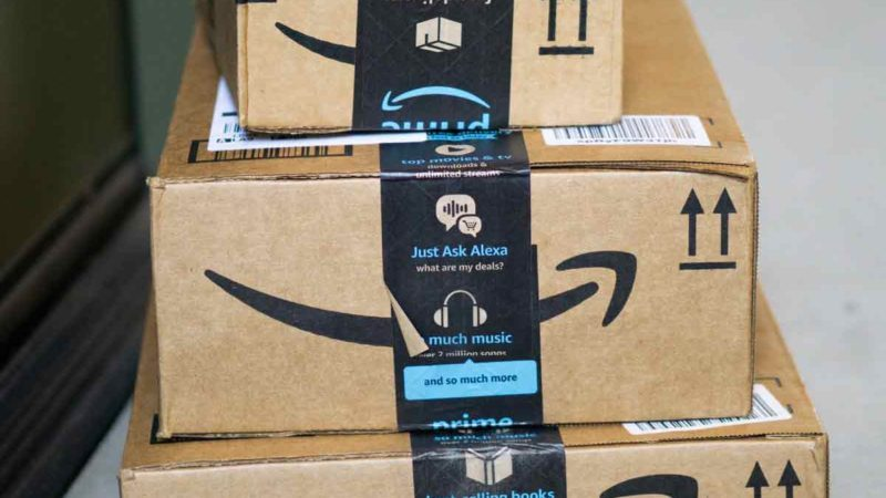 Amazon-flex-delivery-door-to-door-packages-Amazon-Prime-day-putting-box-in-front-of-apartment-room-in-California