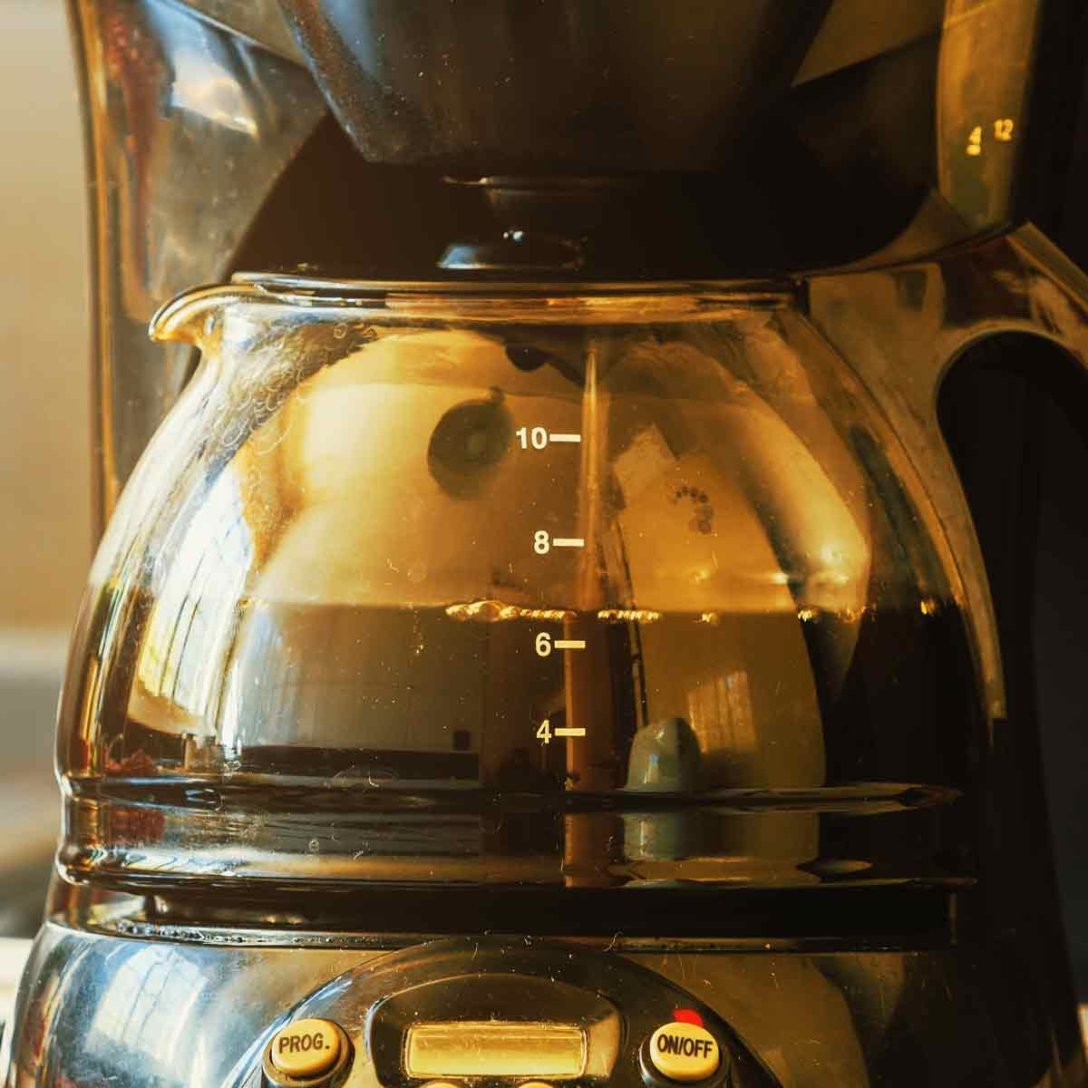 Close-up-of-electric-glass-coffee-pot-with-measurer