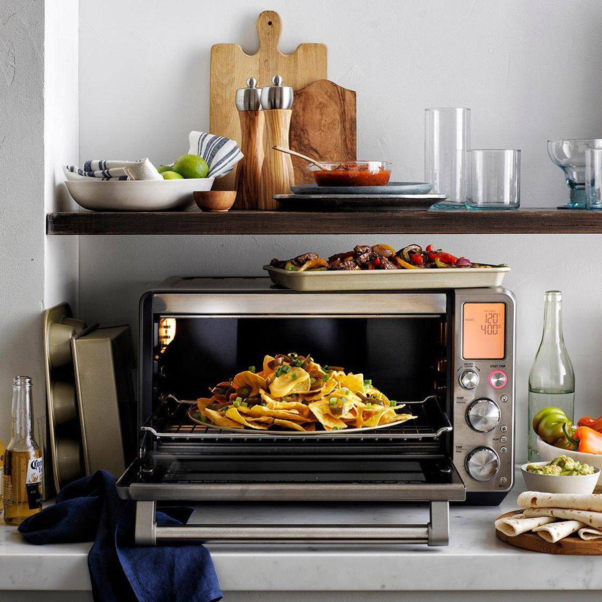 Williams Sonoma toaster oven with nachos and beer