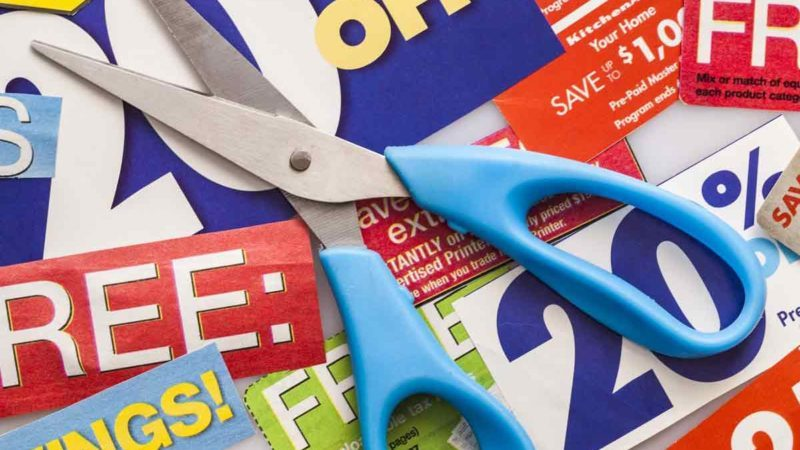 Light-blue-handled-scissors-on-top-of-coupons