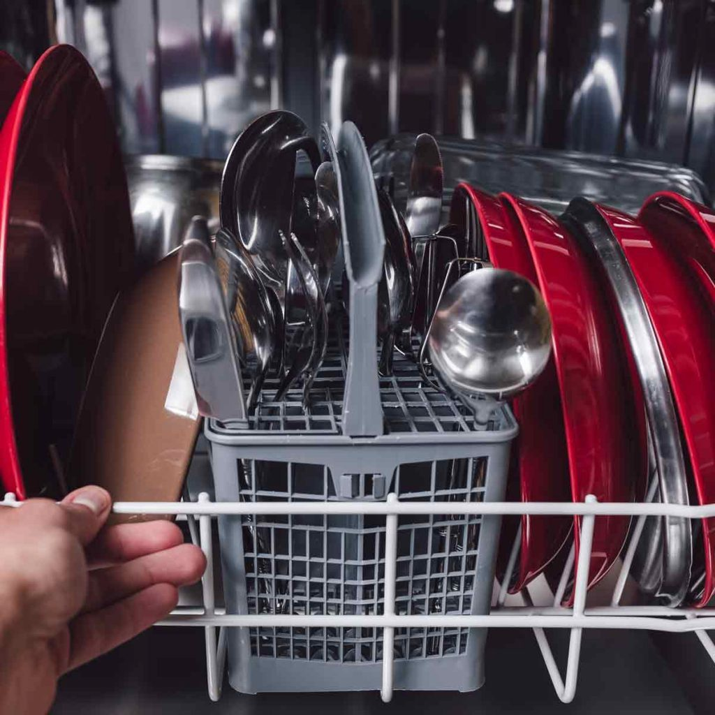 Open-dishwasher-with-clean-utensils-in-it