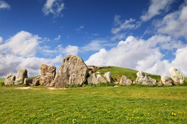 The West Kennet Long Barrow is part of the Avebury Neolithic complex in Wiltshire, England. It is one of the largest and most impressive burial sites in Britain and is much visited.
