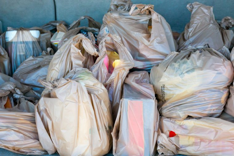 Plastic Bags full of groceries in the trunk