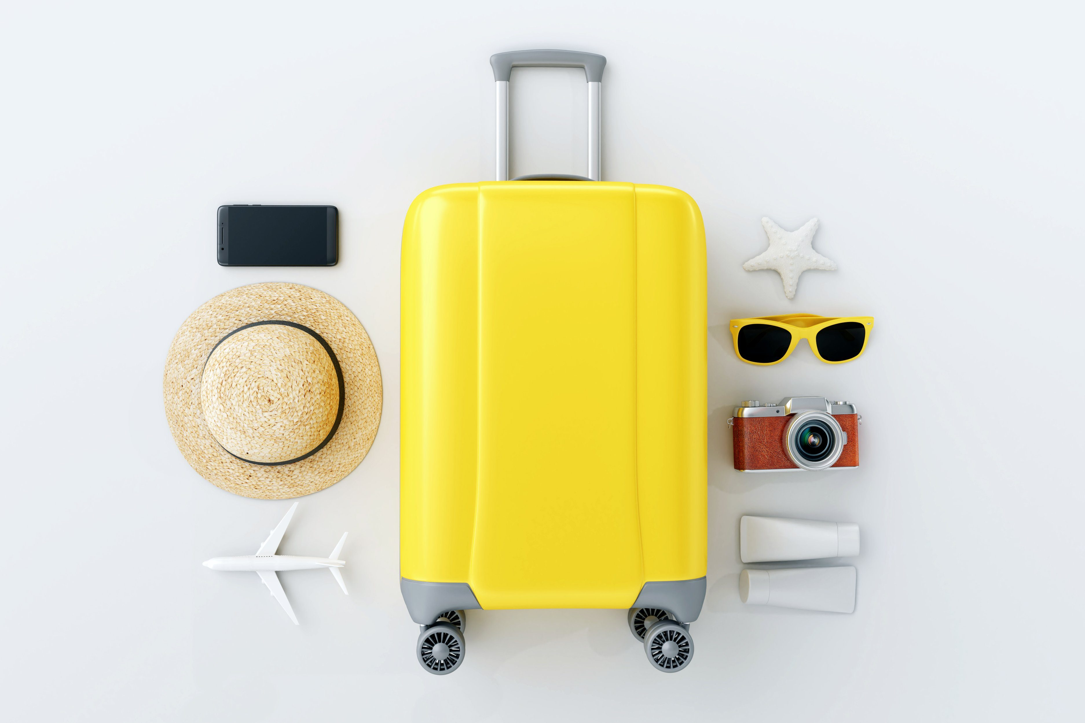 Flat lay yellow suitcase with traveler accessories on white bright background. travel concept; Shutterstock ID 1109787203