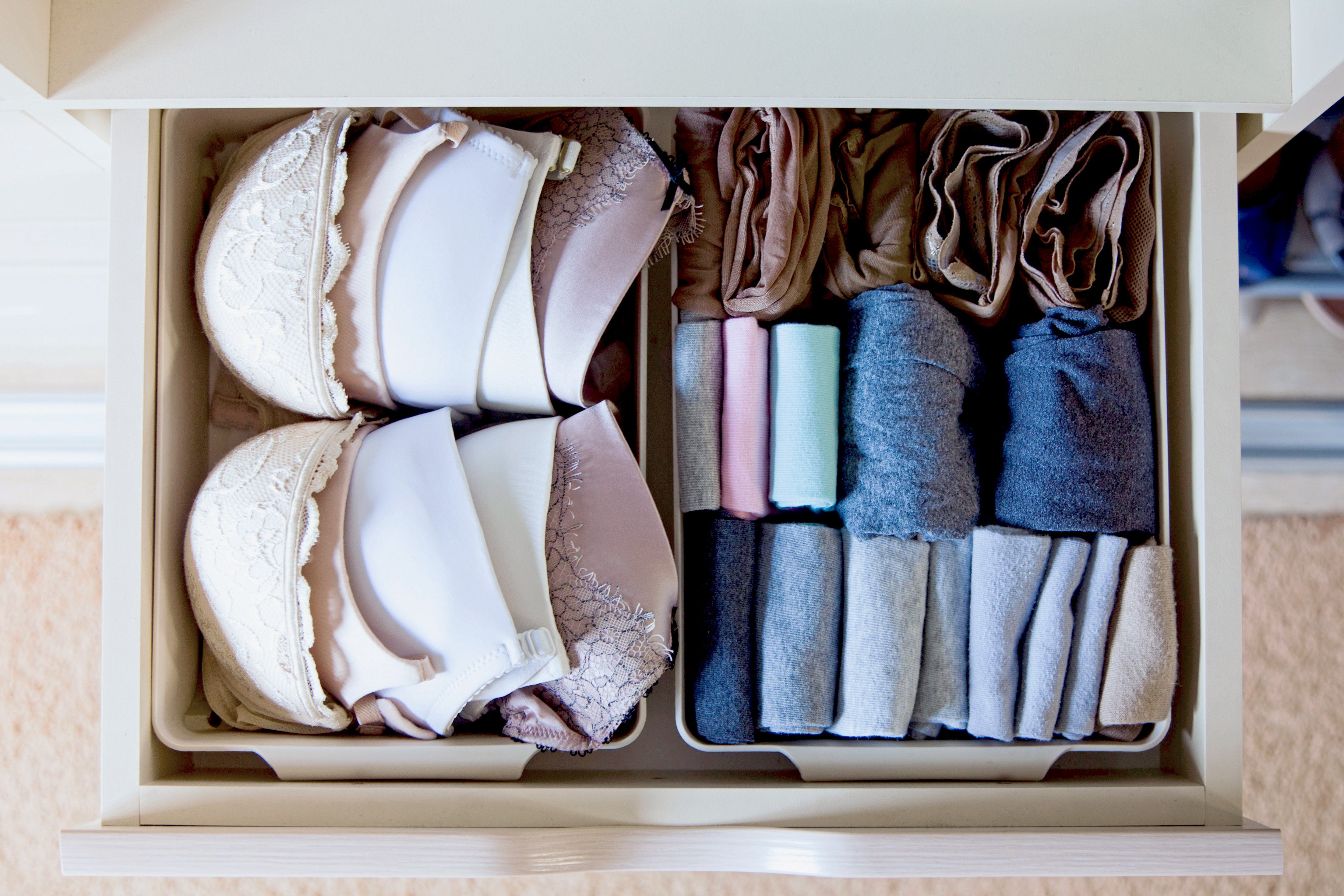 Drawer with underwear, socks, bras and bedding in the closet. Women's Clothing lying in the locker room. ; Shutterstock ID 1565573614; Job (TFH, TOH, RD, BNB, CWM, CM): RD