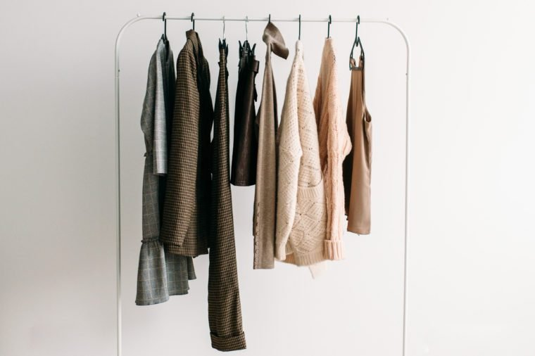 Rack with capsule clothes in beige colors