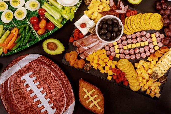 Delicious charcuterie board and veggie with dipping for Super Bowl game football