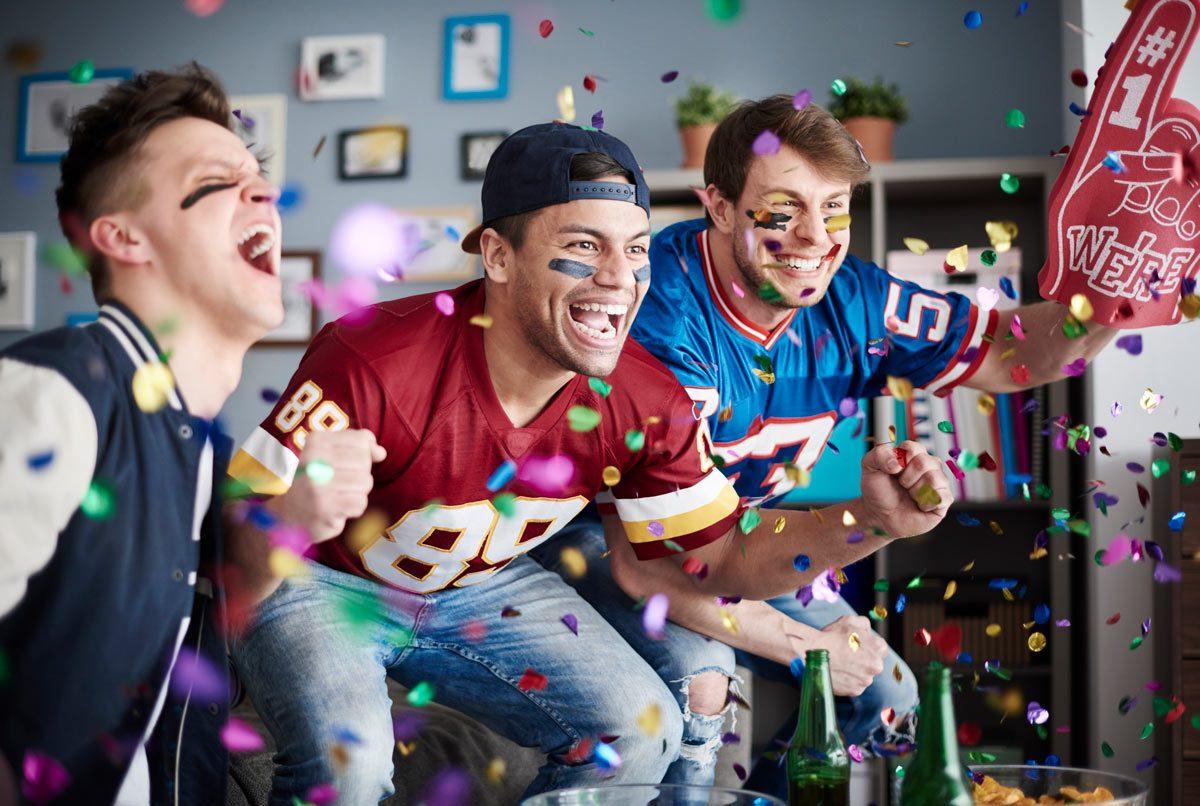 American football fans among falling confetti