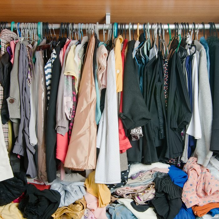 Pile-of-messy-clothes-in-closet.-Untidy-cluttered-woman-wardrobe