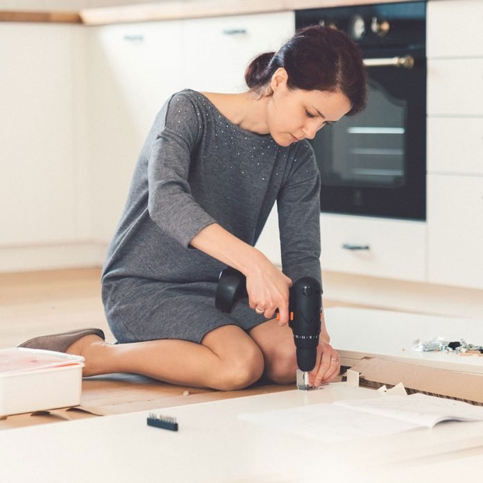 Woman building something in a kitchen