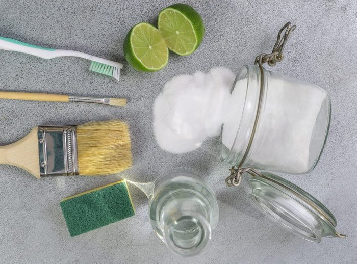 Baking soda, lemon with sponge and objects for effective and safe house cleaning