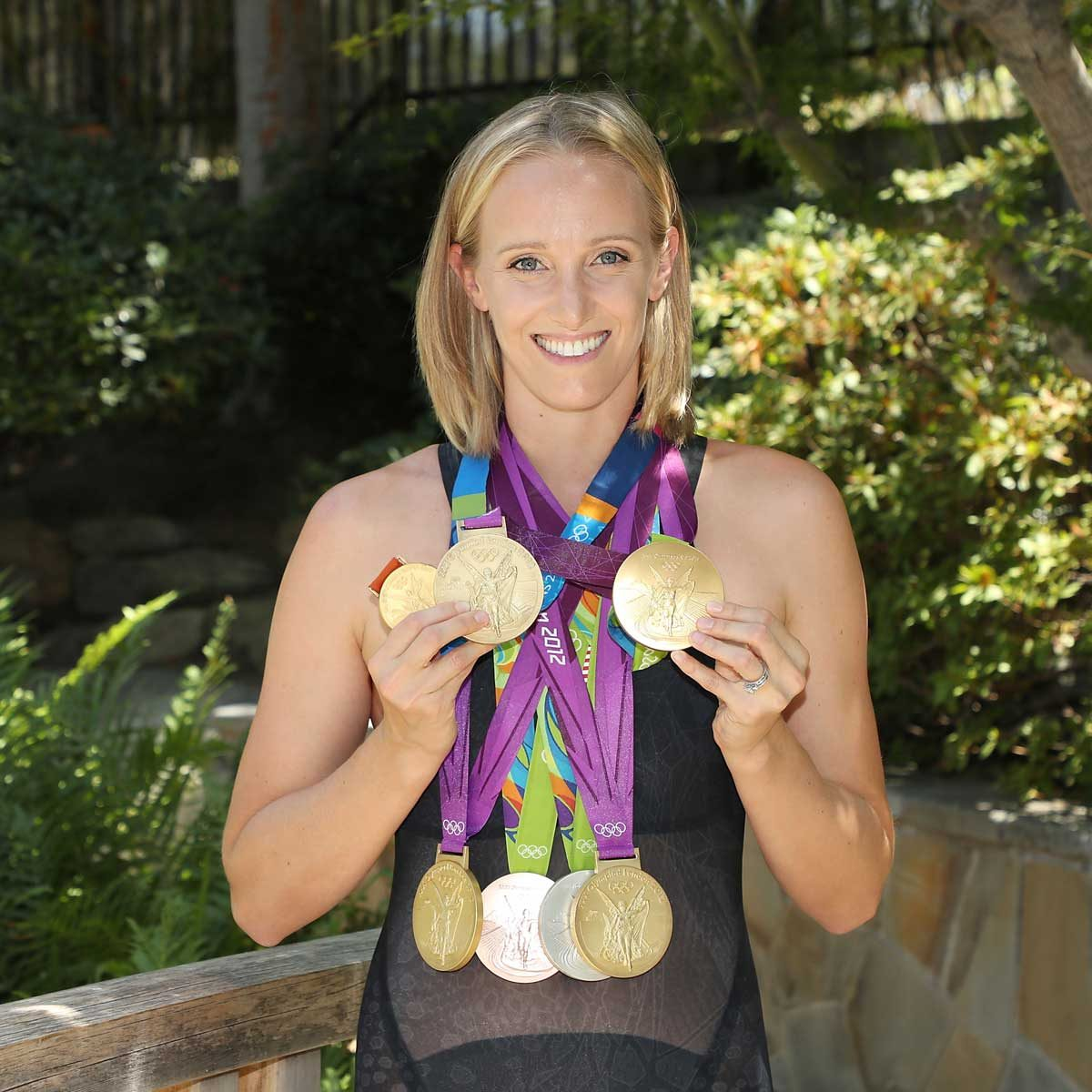 Portrait of Dana Vollmer holding her Olympic medals