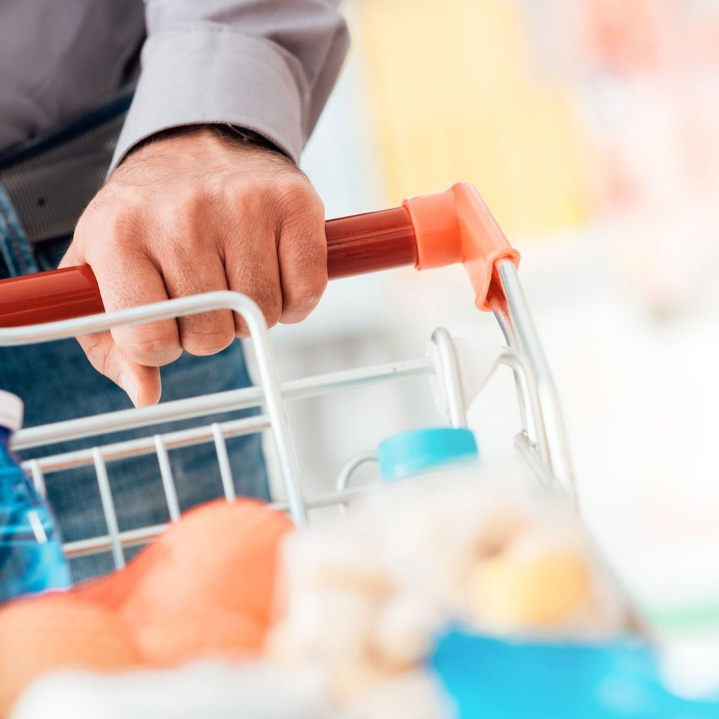 Man pushing grocery cart while stocking up for a quarantine