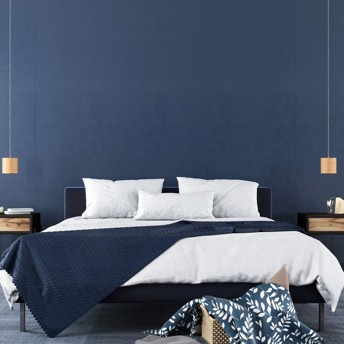 Bedroom with navy blue walls and accents