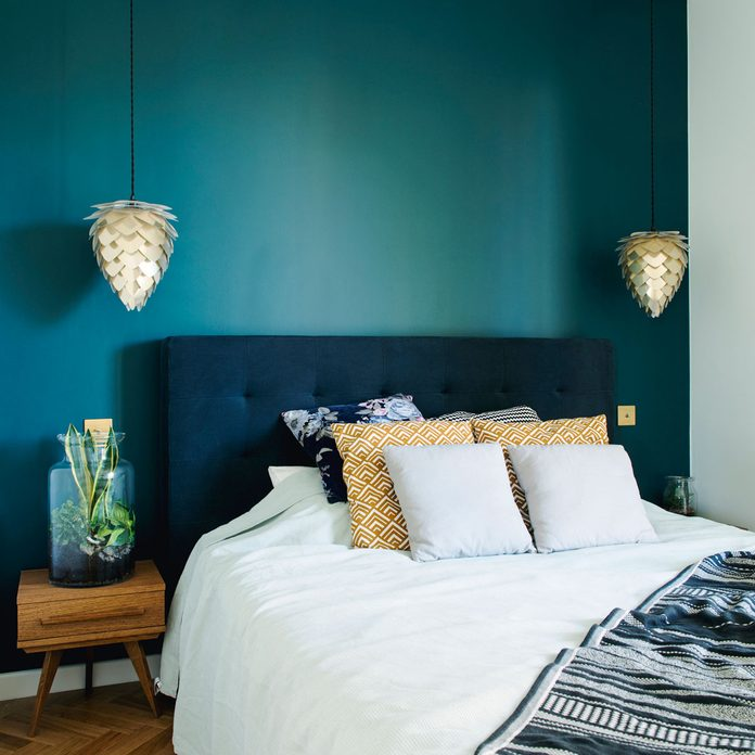 Bedroom with a deep teal accent wall