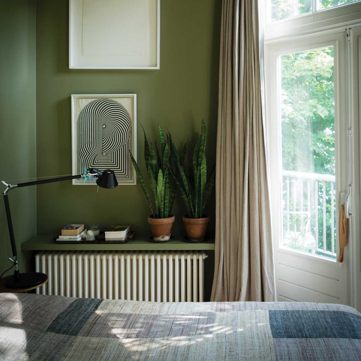 Bedroom with green walls and natural materials