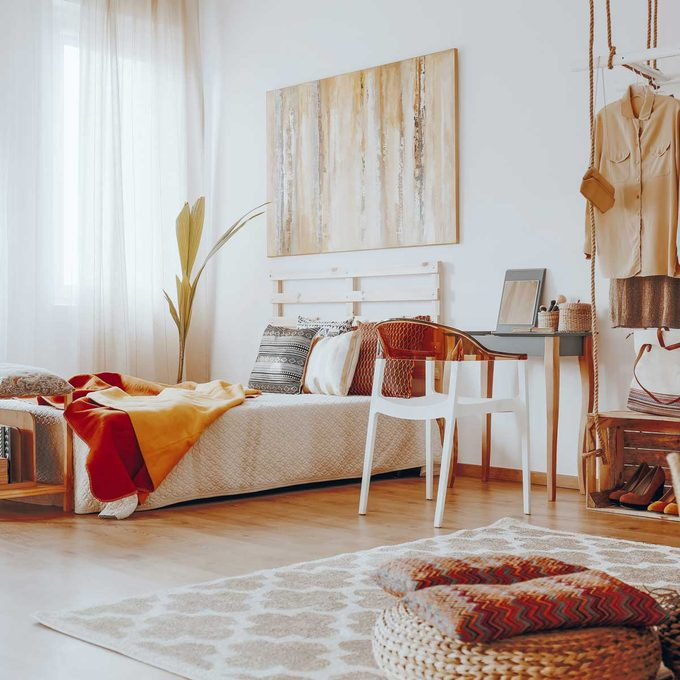 Bedroom with rusty hues and wicker furniture