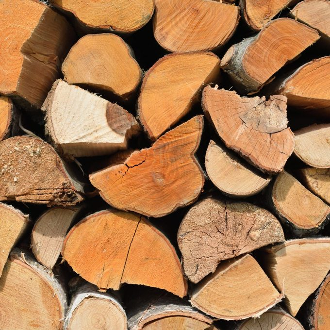 ared for heating the house. Chopped firewood on a stack.