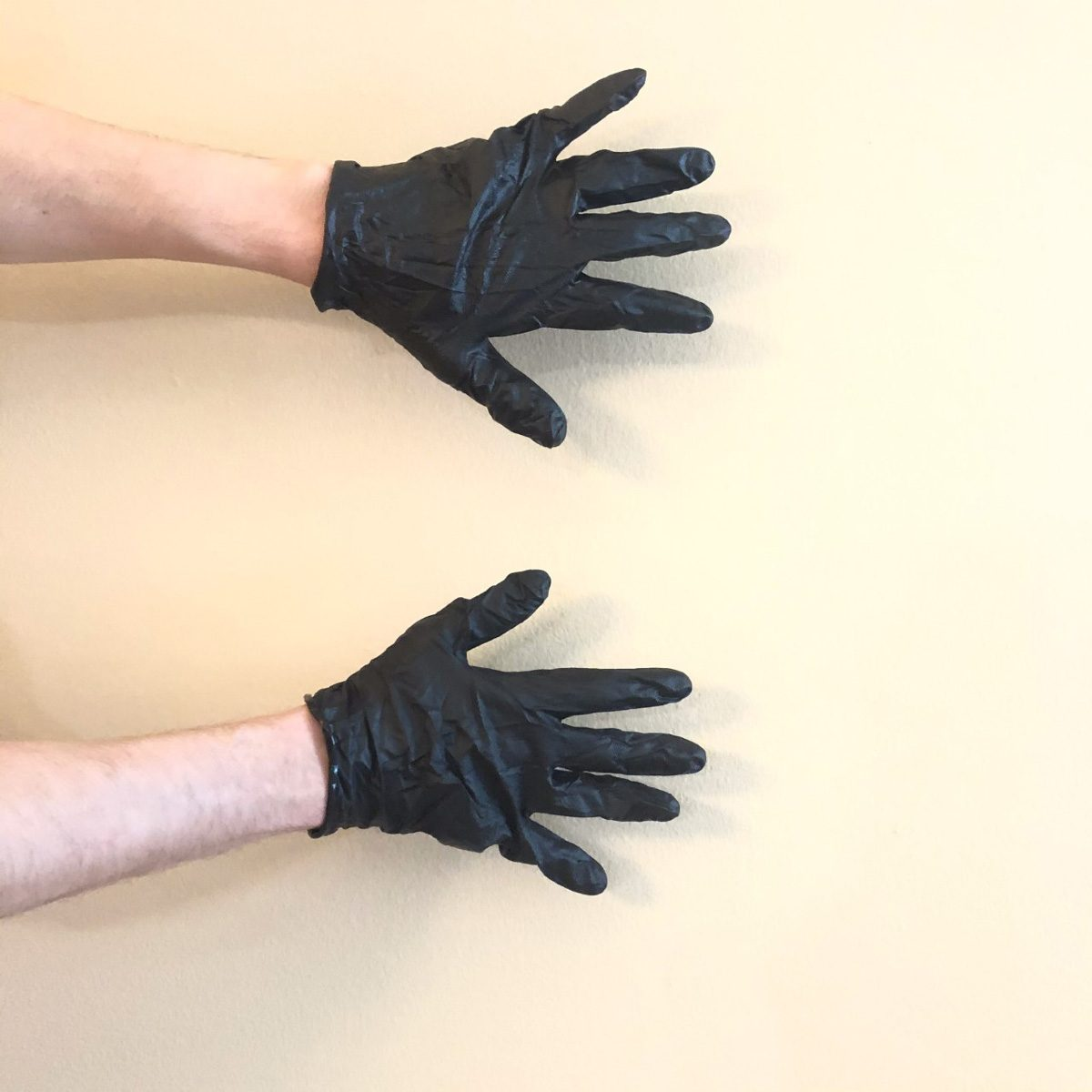 Hands with black nitrile gloves