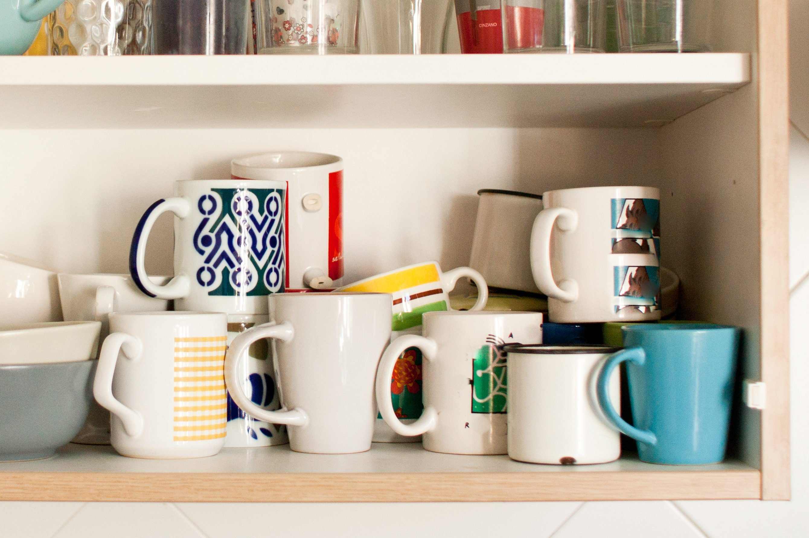 kitchen cabinet with mugs and glasses