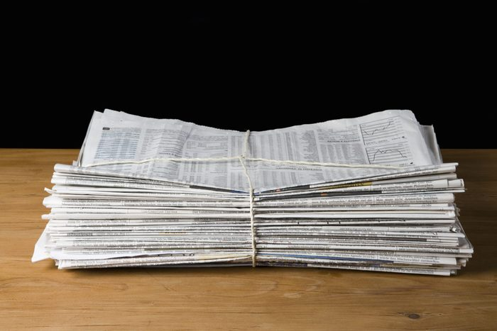 A stack of newspapers tied up with string