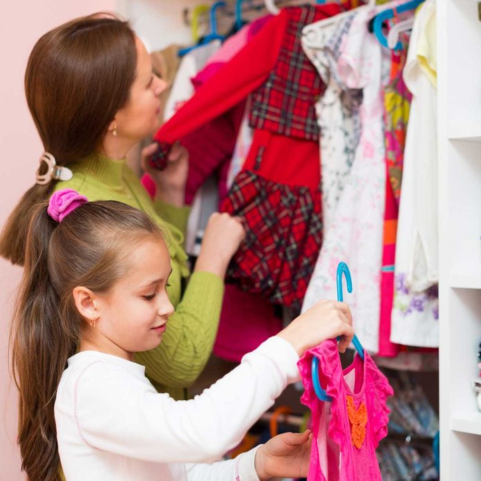 Mon and daughter organizing a closet