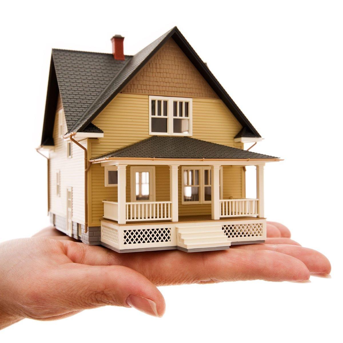 hand holding a miniature house